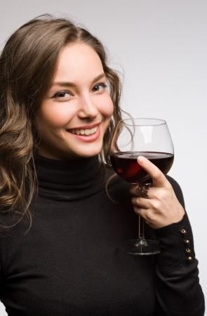 Portrait of a gorgeous young brunette woman enjoying premium wine  photo