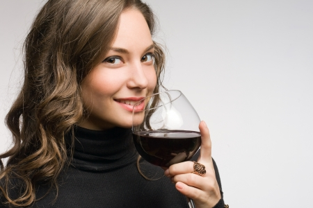 Cool fashionable young brunette woman tasting great wine