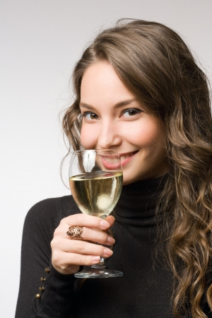 Cool fashionable young brunette woman tasting great wine  photo