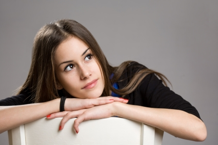 skinny girl: Expressive portrait of cute young brunette teen girl.