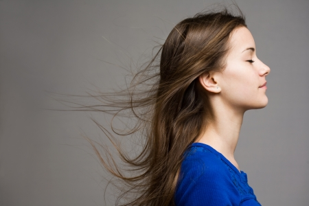 flowing hair: Emotional portrait of dreamy young brunette model.
