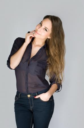 Studio portrait of gorgeous pensive young brunette woman. photo