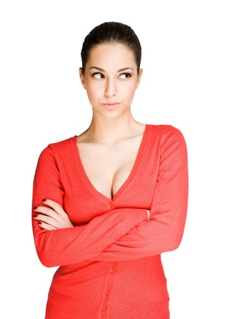 cleavage: Portrait of angry looking brunette beauty on white background.