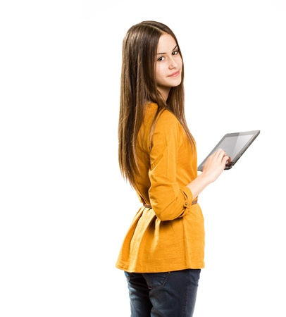 Portrait of a gorgeous teen girl having fun with tablet computer. photo