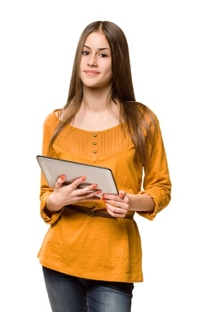 Portrait of a beautiful teen girl using tablet computer. photo