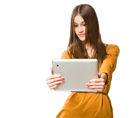 Portrait of beautiful brunette teen using tablet computer. Stock Photo - 18098753
