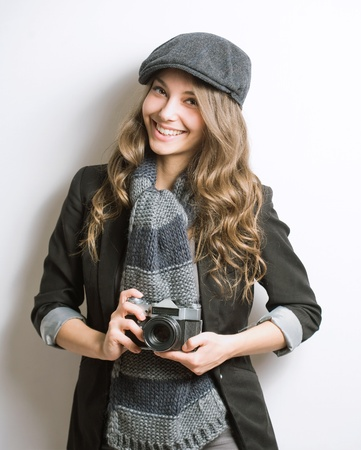 Portrait of fashionable young artist with vintage film camera  photo