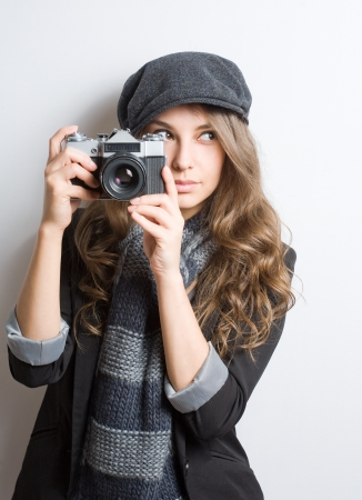 Portrait of fashionable young artist with vintage film camera Stock Photo - 18843470