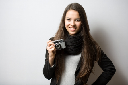 Portrait of cute young teen with her photo camera. photo