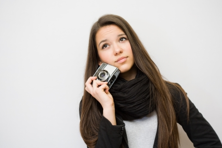 Portrait of cool young brunette with  photo camera. photo