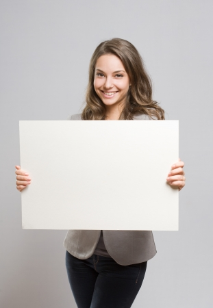 sexy asian girl: Portrait of gorgeous young businesswoman with large blank banner.
