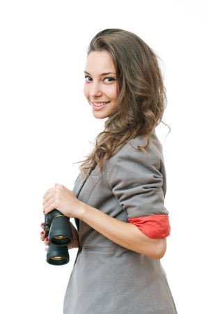 Portrait of fashionable young businesswoman searching the horizon with binoculars  photo