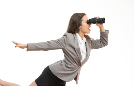 Portrait of a beautiful young brunette businesswoman with seeking with binoculars