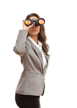 Portrait of fashionable young businesswoman searching the horizon with binoculars  Stock Photo