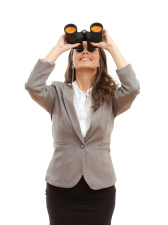 looking for a job: Portrait of a beautiful young brunette businesswoman with seeking with binoculars