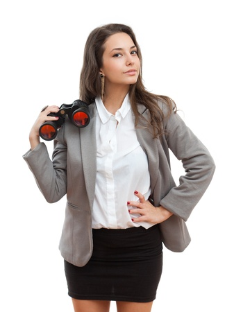Portrait of a beautiful young brunette businesswoman with seeking with binoculars  photo