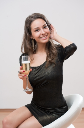 Portrait of gorgeous young brunette festive champagne girl. photo