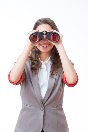 looking for a job: Portrait of brunette beauty holding binoculars isolated on white background.