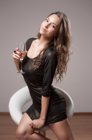 barstool: Portrait of gorgeous party girl in sequin dress.