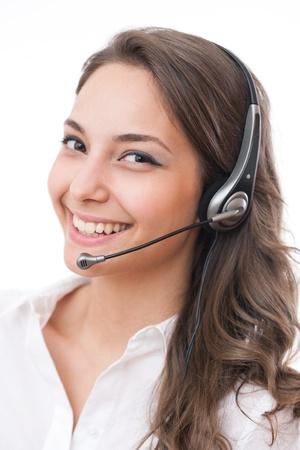Beautiful young brunette woman in offfice wearing headset. photo