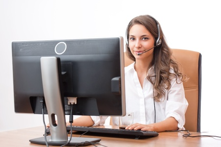 Portrait of smiling friendly office girl wearing headset. photo