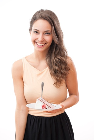 woman eating cake: Portrait of happy young fit brunette woman with tasty cake.