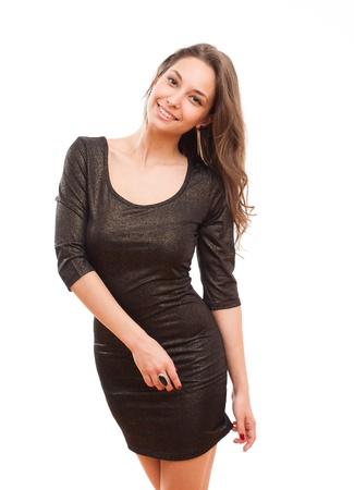 Portrait of beautiful slender brunette woman posing in black dress Stockfoto