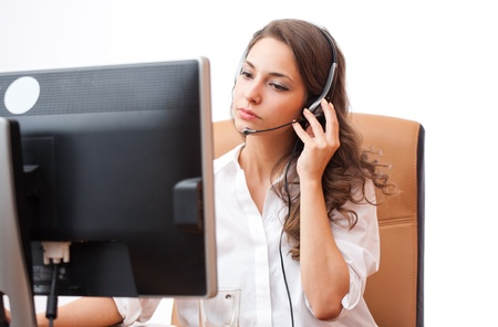 helpdesk: Portrait of a fashionable cute office girl wearing headset. Stock Photo