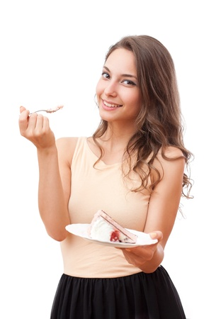 woman eating cake: Beautiful young brunette woman being tempted by pastry.