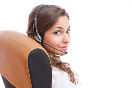 Portrait of fashionable young brunette businesswoman with headset. photo