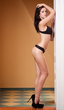 Portrait of beautiful slender leggy lingerie girl. Stock Photo