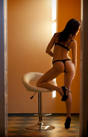 thong: Gorgeous lingerie model in sensual moody light.