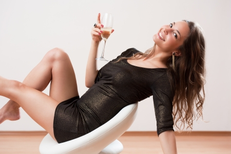 sexy asian woman: Portrait of a sensual young bunette party girl holding glass of champagne.