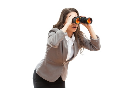 Portrait of surprised looking young office girl with binoculars.