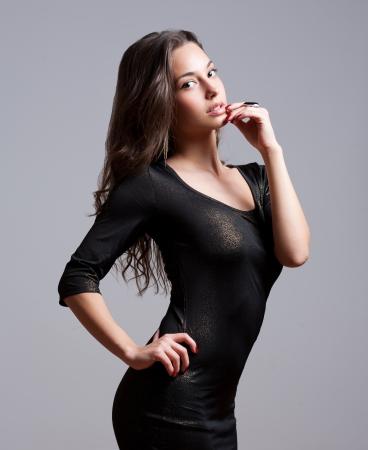 sequin: Portrait of sensual young festive brunette in sequin dress.