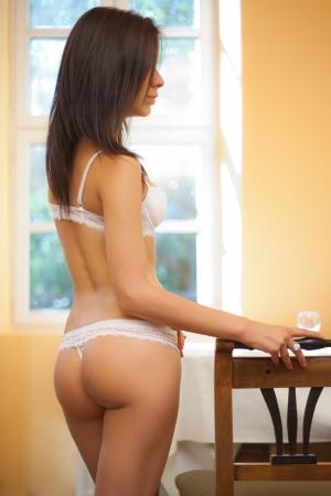 Gorgeous slender lingerie model in soft light  photo