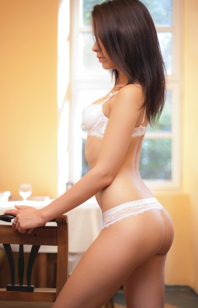 thong: Portrait of dreamy relaxed lingerie babe in smooth lighting