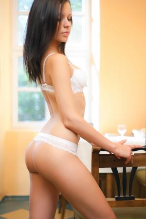 thong woman: Gorgeous slender lingerie model in soft light
