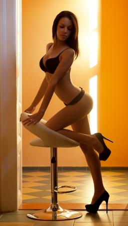 Sexy full length portrait of slender lingerie babe  Stock Photo