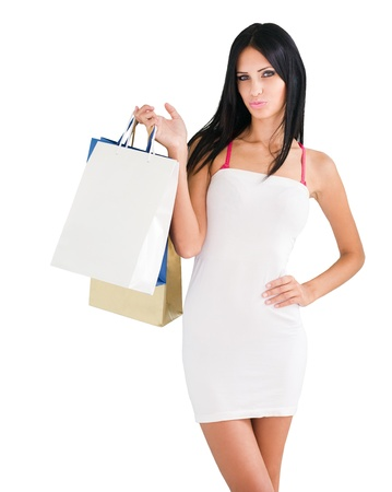 Portrait of gorgeous tanned young brunette woman holding shopping bags. photo