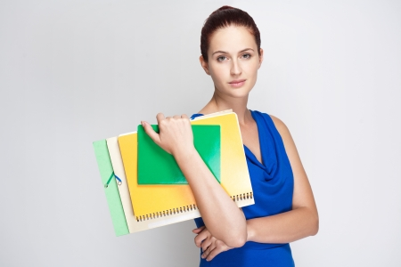 Portrait of attractive young student with colorful exercise books and folders. Stock Photo - 21901578