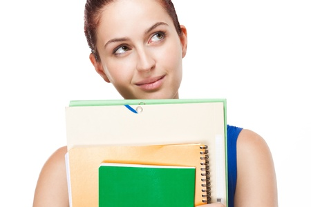 choose university: Portrait of attractive young student with colorful exercise books and folders.