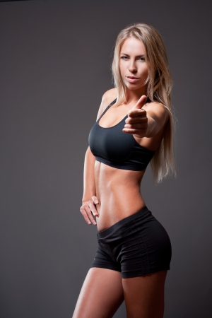 Very fit slim and slender young woman. photo