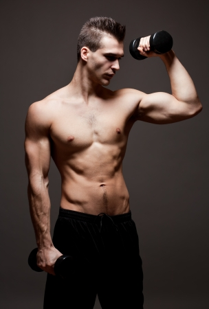 Portrait of a confident looking very lean fit young male athlete. photo