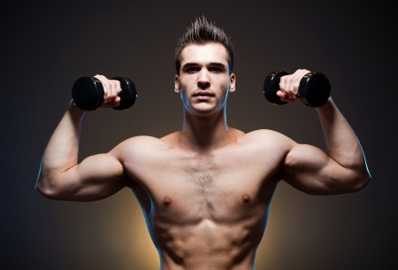 male torso: Dark moody portrait of very fit ripped young athlete.
