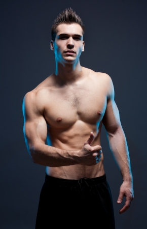 male athlete: Portrait of a confident looking very lean fit young male athlete.