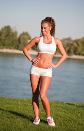 Portrait of gorgeous sporty young brunette having fitness fun outdoors.