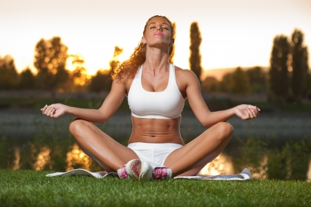Gorgeous very fit young brunette having great workout outdoors.
