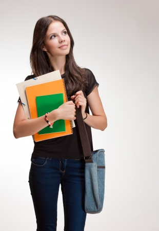 Portrait of a very attractive young student girl. Stock Photo - 22349460