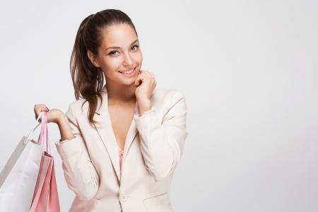 Portrait of a fashionable gorgeous young brunette shopper